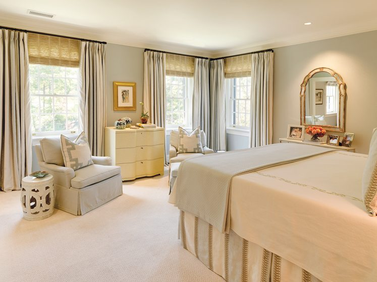 The serene master bedroom is a far cry from its predecessor.