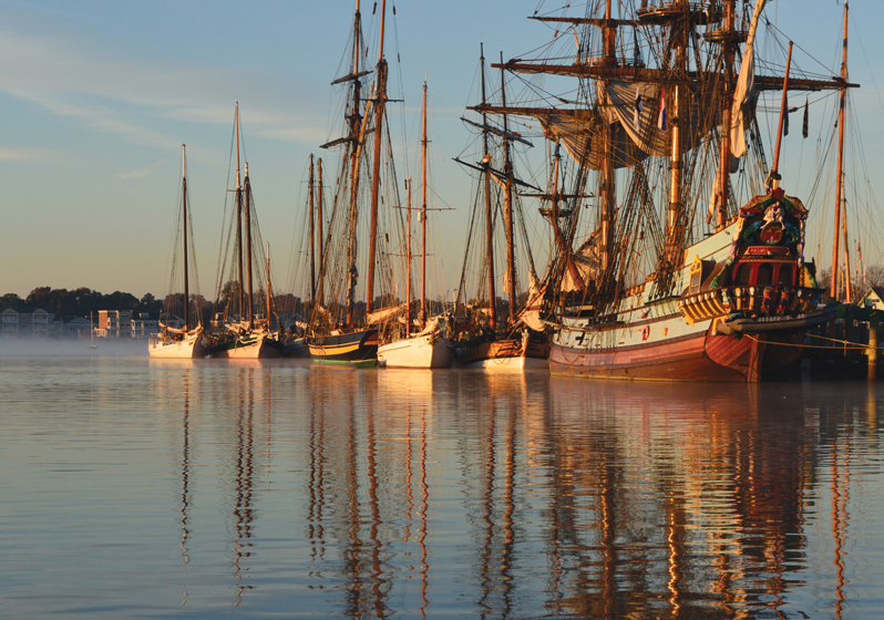 Tall ships, gathered for Downrigging Weekend in the port at Chestertown, conjure a bygone era.