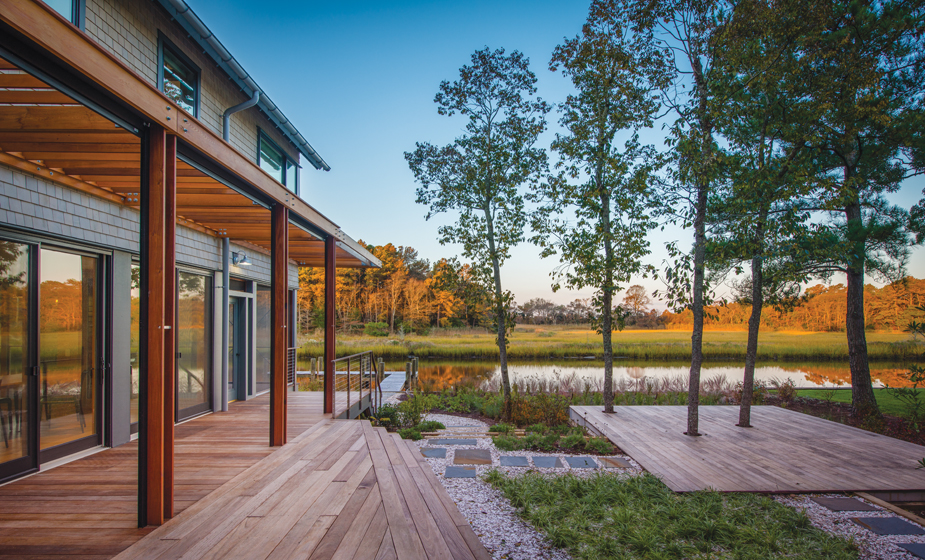 A courtyard behind the house yields breathtaking views of the canal and wetlands beyond.