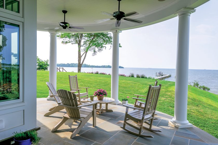 On the porch under the turret, Adirondack and rocking chairs from Seaside Casual provide seating.