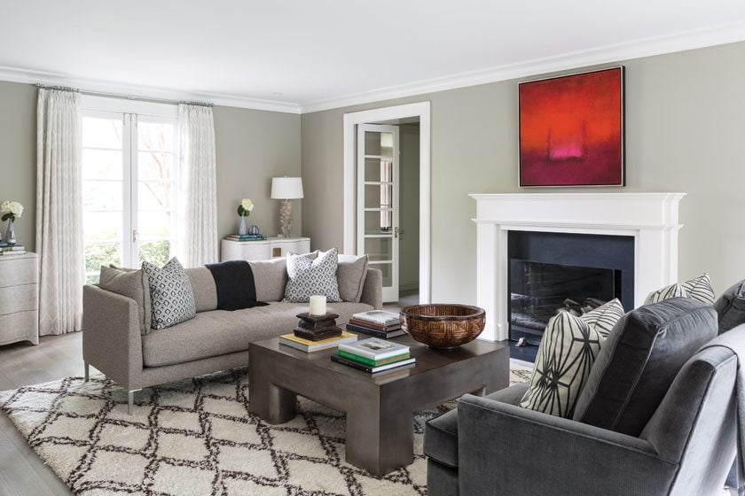 Meyer updated the living room with a new stone fireplace surround and a rug from Galleria Carpets.