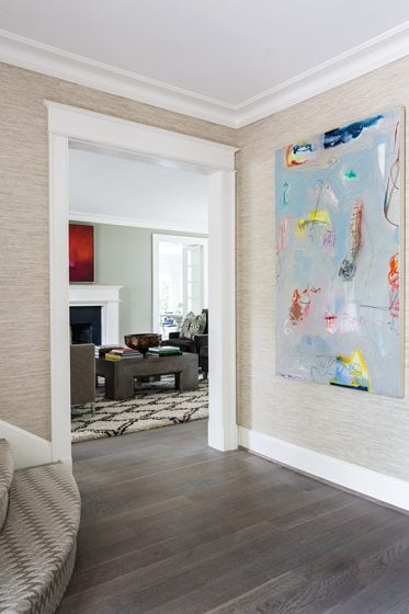 An abstract painting by Lamar Briggs dominates the foyer.