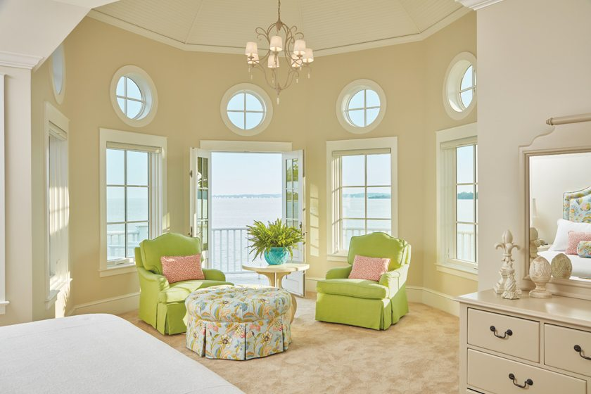 Bold lime fabric adorns cozy chairs in the master bedroom seating area.