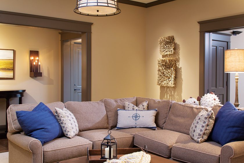 In the media room, a sectional offers a cozy refuge.