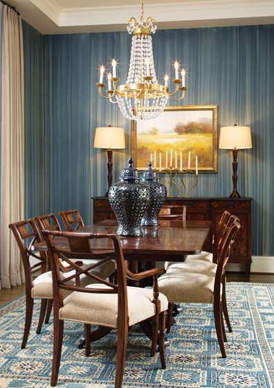 The formal dining room offers a nod to  the Chesapeake with its blue striae wall treatment by Warnock Studios.