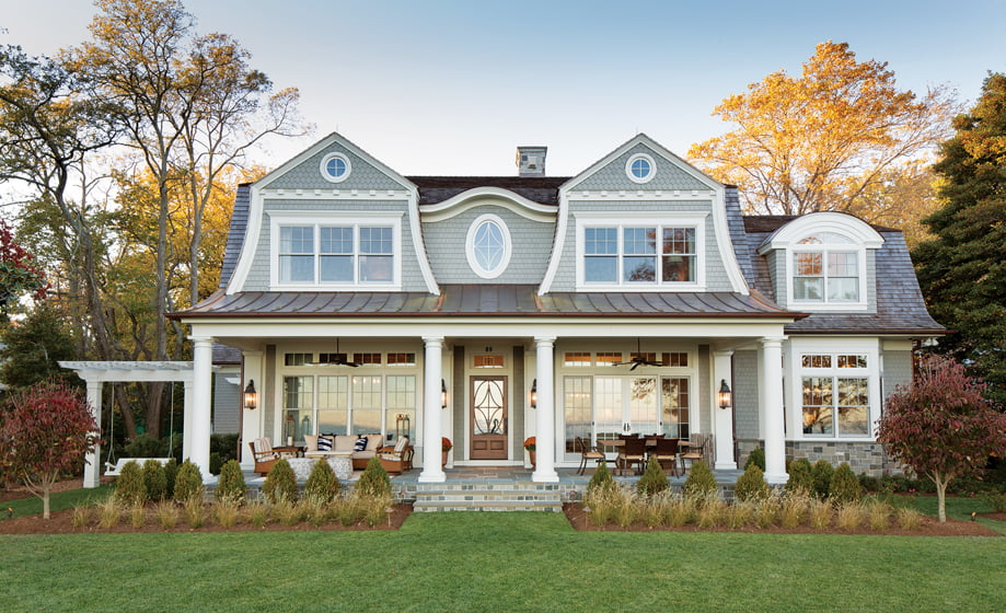 On axis with the front entry, the back door leads to the waterfront porch, rimmed by beds of native grasses.