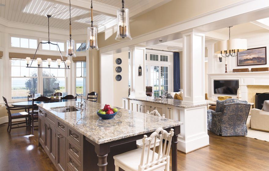 Joni Zimmerman designed the expansive kitchen. In the main space, a breakfast area overlooks the bay.