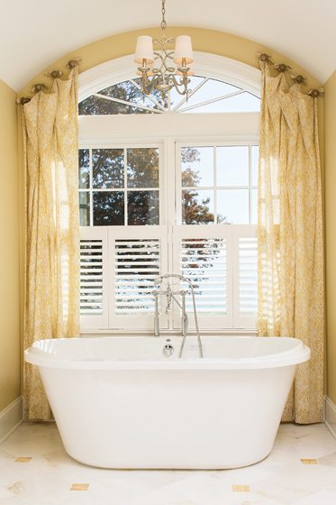 A soaking tub offers a view from the master bath.