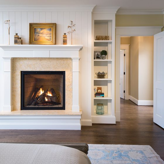 A fireplace is surrounded by Jerusalem Gold limestone.