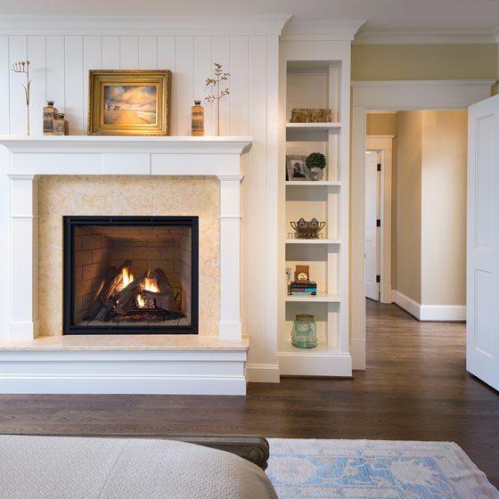 A fireplace is surrounded by Jerusalem Gold limestone.