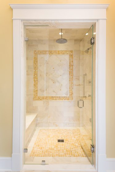 A shower with onyx accents pampers the owners in style.