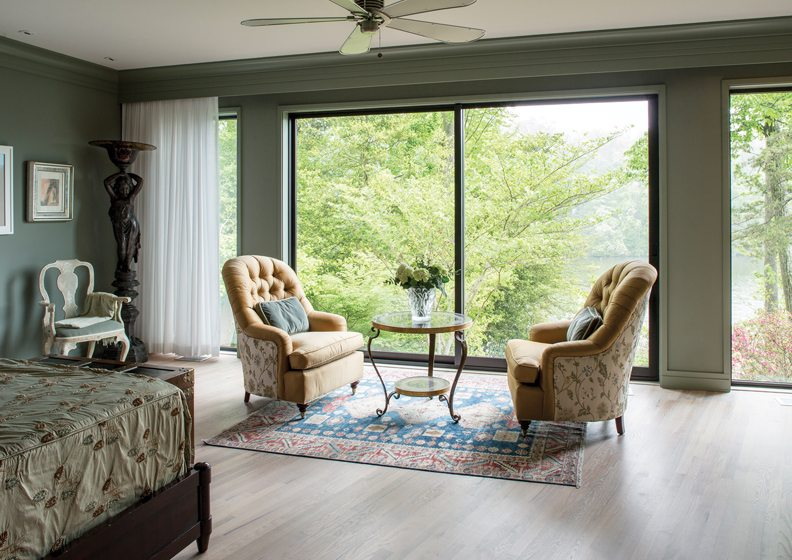 Baker armchairs frame the view from the master bedroom.