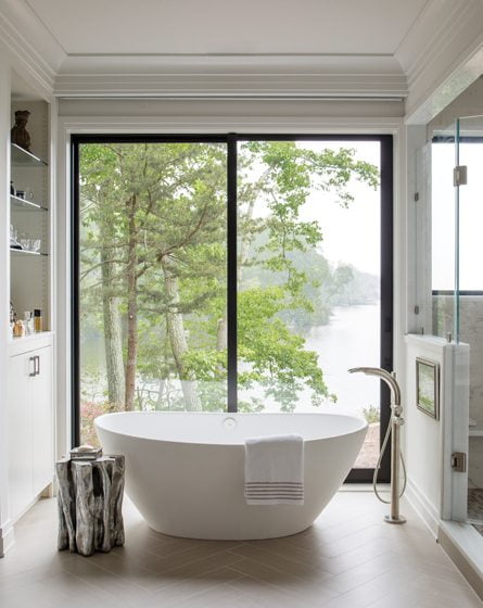 An MTI tub centers on a picture window in the master bath.
