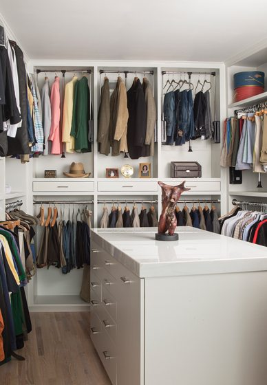 His-and-her closets were built onsite with marble-topped islands.