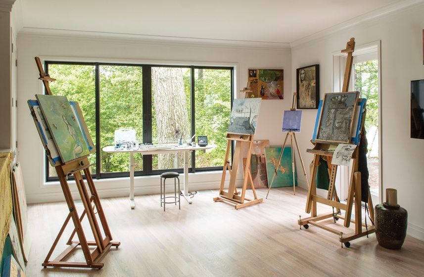 Large windows and skylights bathe the owner's art studio with plenty of natural light.