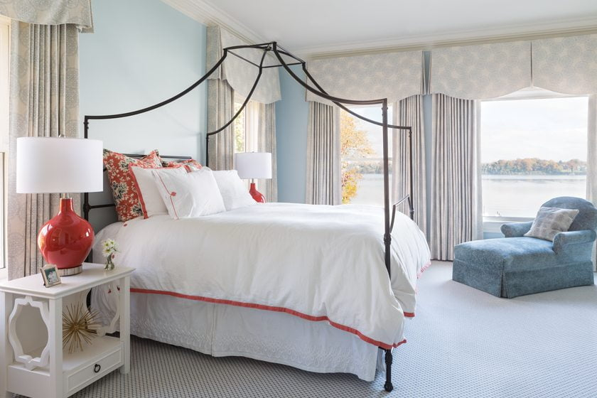 A canopy bed from PBteen and crisp bedding from Serena & Lily create a girl's retreat.