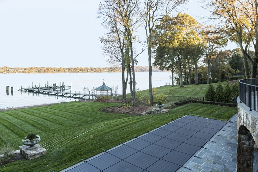 The backyard slopes gently down to a gazebo and dock on the shore of the Potomac River.