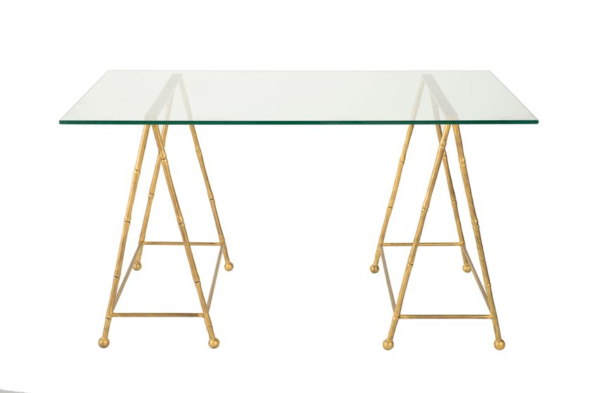 Michael Hampton's Bamboo Desk, shown with a painted-gold metal base and glass top.