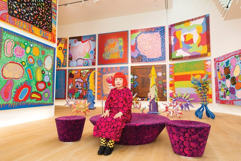 In a portrait, Yayoi Kusama wears her signature polka dots.