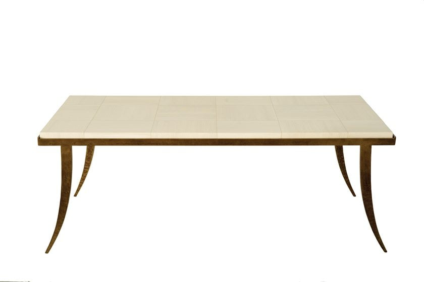 The stone-topped Klismos Coffee Table, with its base finished in bronze.
