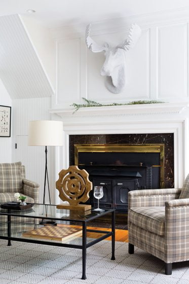 The wife's  home office retains its original beadboard walls and fireplace—now painted crisp white.