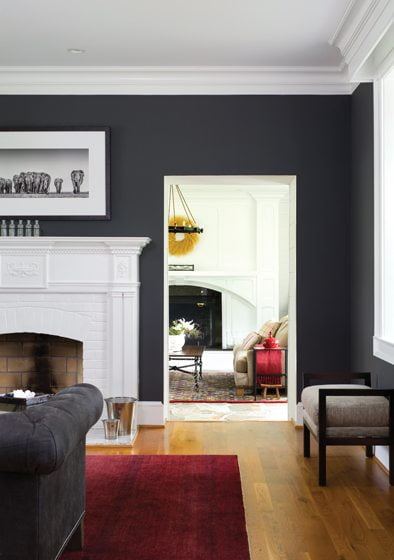The great room is visible from the charcoal-hued living room.