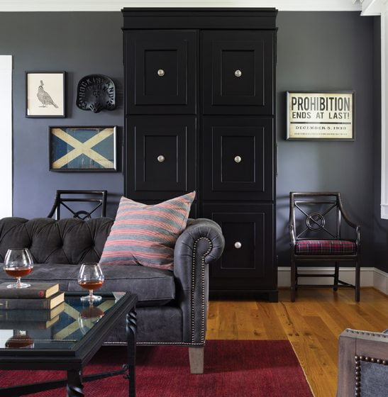 A custom bar cabinet in the living room is flanked by McGuire chairs with cushions covered in Scottish plaid.