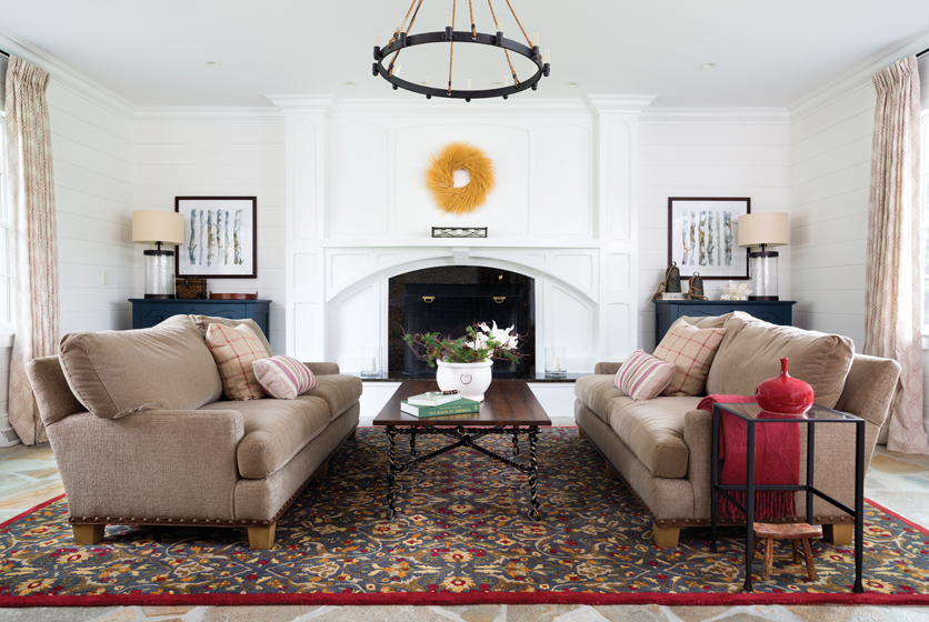 Kaplan transformed the great room with new tongue-and-groove paneling, a stone floor and white-painted millwork.