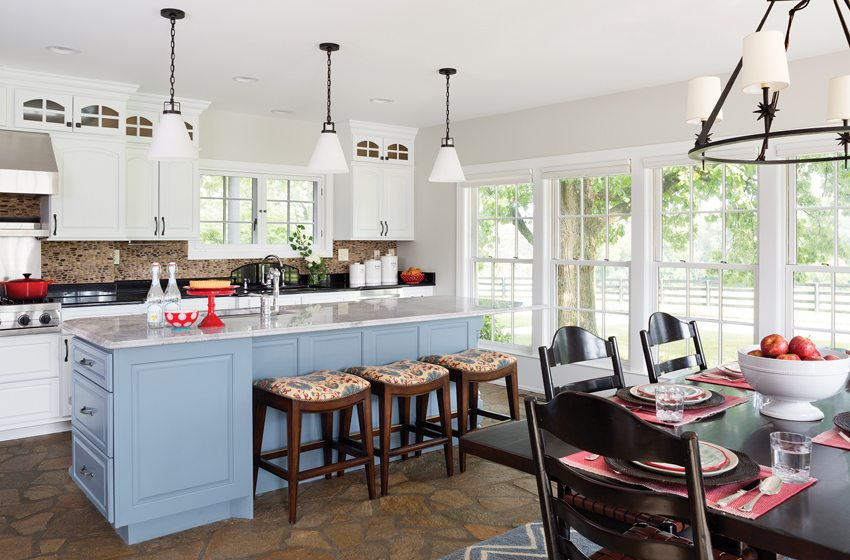 Kaplan lightened the existing kitchen by painting the cabinets white and the island blue.