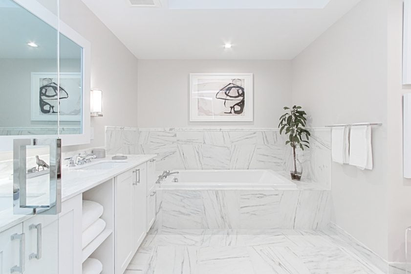 Calacatta Gold marble clads the model's spa-like master bath. © Studio Trejo