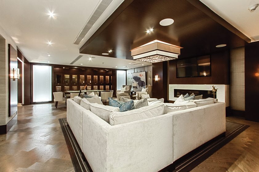 The Onyx Lounge offers wine storage and a comfortable sectional facing a large, flat-screen TV. © Studio Trejo