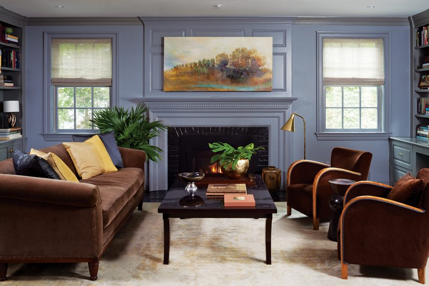 Roman shades in the gray-paneled library are by Hartmann&Forbes; accessories were sourced at Mecox Gardens.