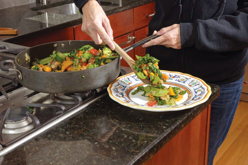 Plating the vegetables.