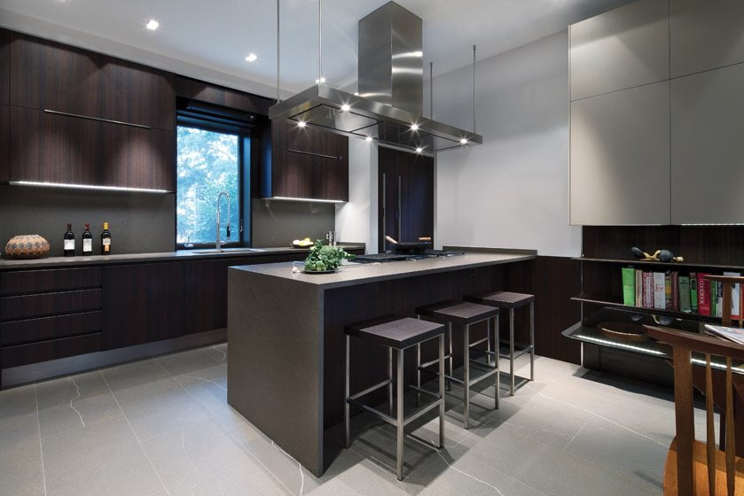 A five-foot-long cooktop on the peninsula encompasses a grill, a wok, gas and induction burners with a large canopy hood above.