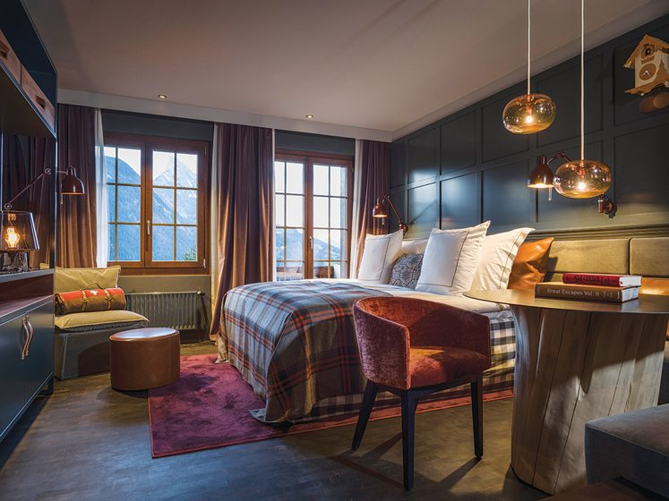 A cozy guest room in the Huus Hotel.