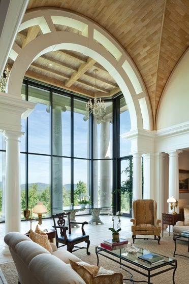Off the main sitting room, glass-topped tables made from hand-carved Corinthian capitals on wheels keep views open.