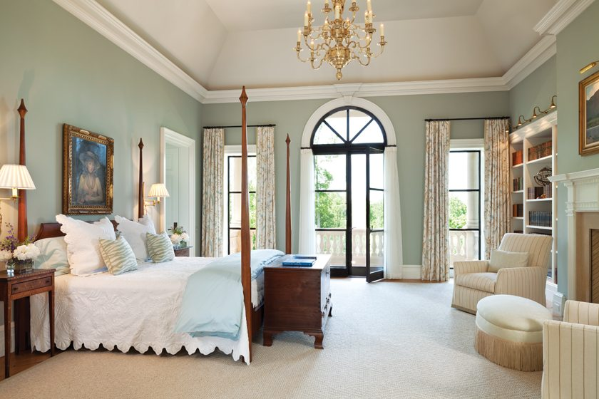 With pale blue walls and drapes sporting a bird motif, R. David Craig created a garden feel in one guest room.