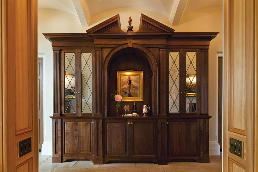 Robert Paxton designed a walnut cabinet with wood felled on site. It doubles as a bar with sink and refrigerator.
