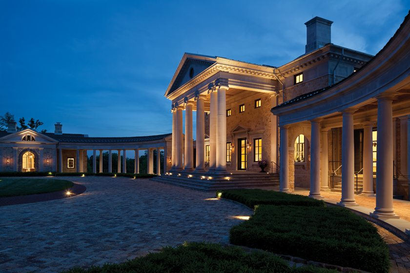Built to last for centuries, the home is clad in hand-molded brick and quarried limestone and flanked by sweeping colonnades.