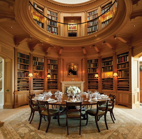 The circa-1840 William Jupe table dictated the size of the two-story library/dining room.