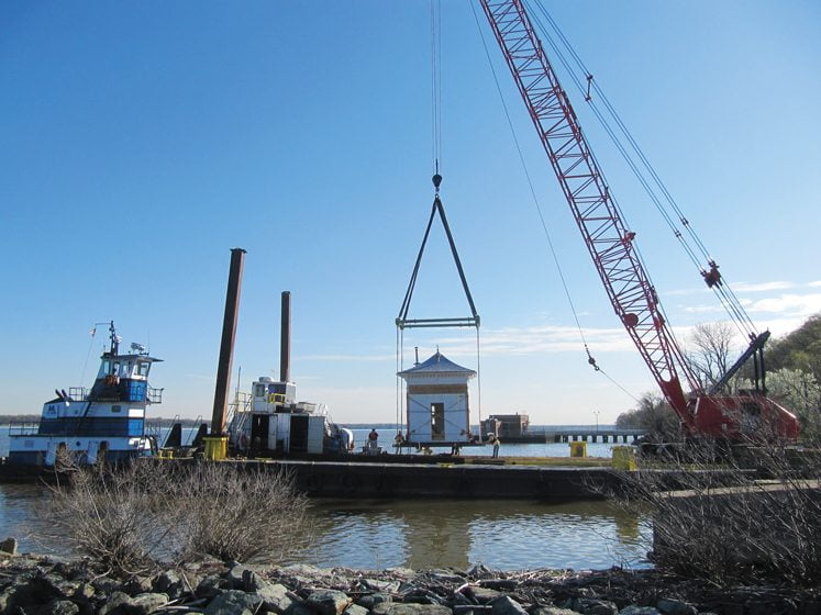 The building was lifted onto a barge for the trip upriver to the Navy Yard in Southeast DC.