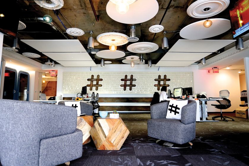 "In Twitter's DC office, Swatchroom created a ""Hashtag Flag"" made of laser-cut styrene feathers."