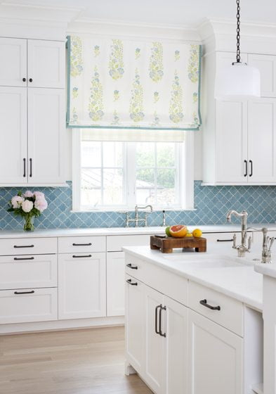 The kitchen's Roman shade is fashioned from Galbraith & Paul fabric.