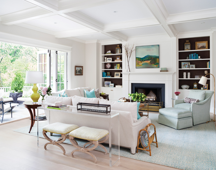 In the family room, shades of turquoise range from the Galbraith & Paul rug to the Manuel Canovas armchair fabric.
