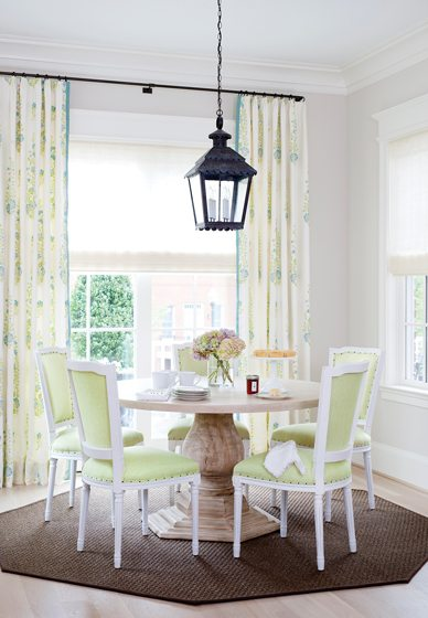 A John Rosselli lantern in a verdigris finish hangs above a Custom Furniture L.A. table in the breakfast nook.