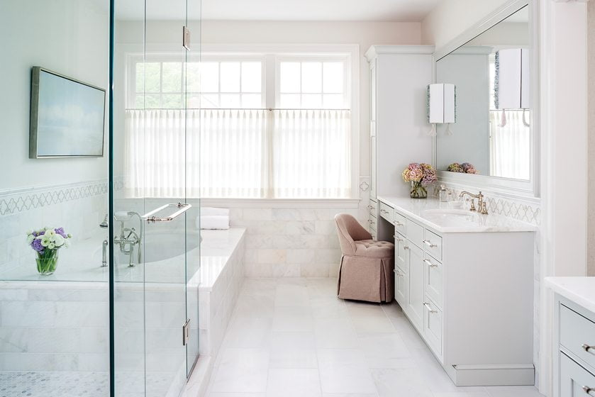 The master bath boasts tile from Architectural Ceramics and sconces from Ro Sham Beaux.