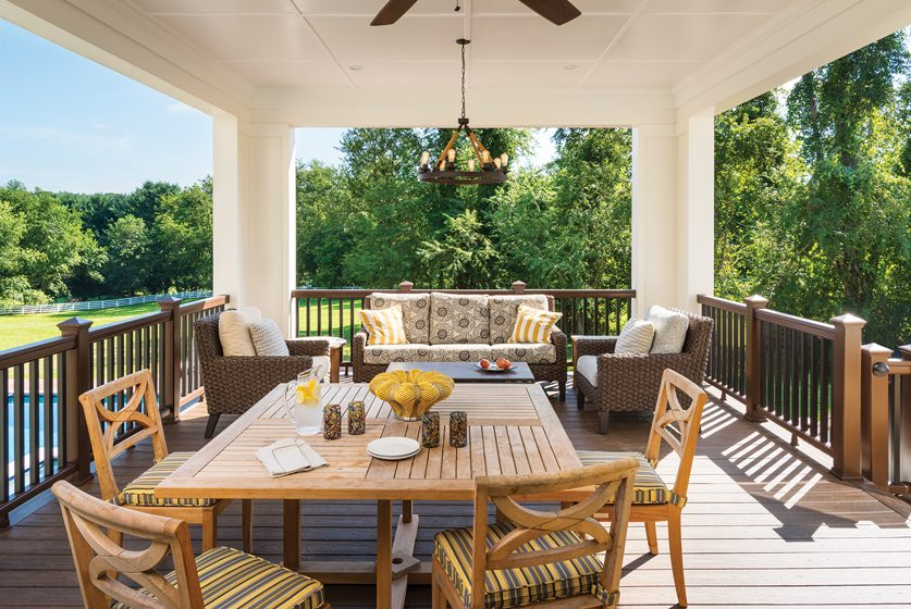 Off the kitchen, a lanai makes a cozy perch overlooking the landscape.