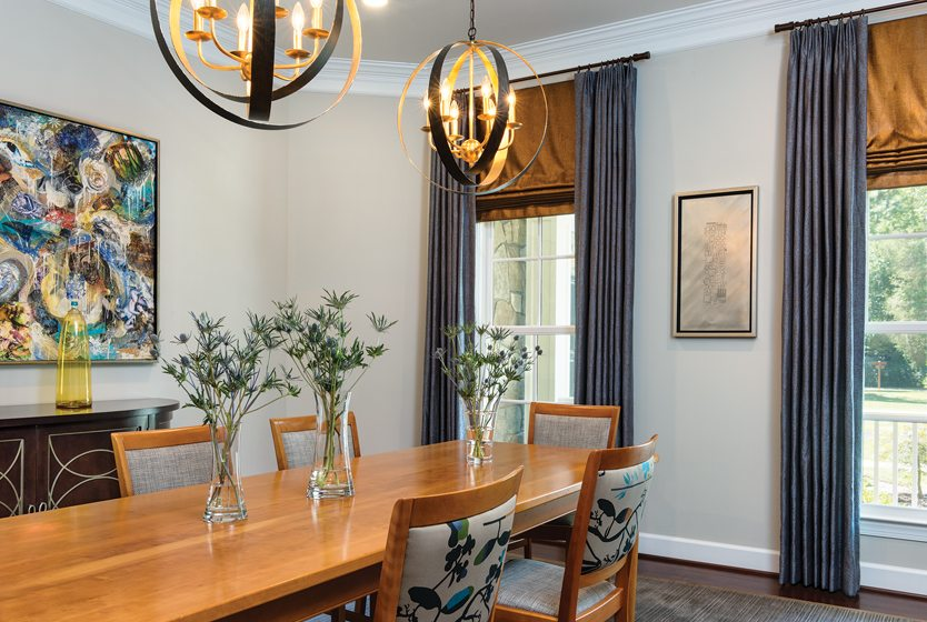 Crystorama pendants and chair backs in Maharam fabric enhance the dining room.