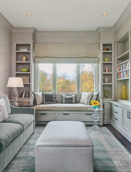The library/guest room boasts a soothing celadon palette and custom window seat.