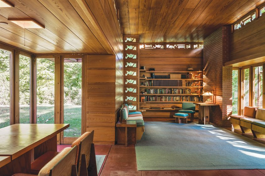 Inside, visitors will discover built-in shelving and furniture designed by Wright.